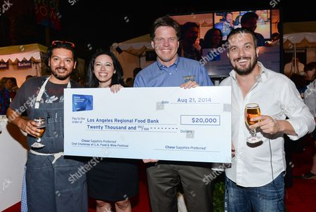 Chef Ray Garcia, left, Lauren Furgione, Vice President of Chase Sapphire, Michael Flood, President and CEO of Los Angeles Regional Food Bank, and Chef Fabio Viviani are awarded a $20,000 donation for Los Angeles Regional Food Bank at the Chase Sapphire Preferred Chef Challenge during the Ultimate Bites of L.A. at the Los Angeles Food & Wine Festival, presented by FOOD & WINE, on in Los Angeles