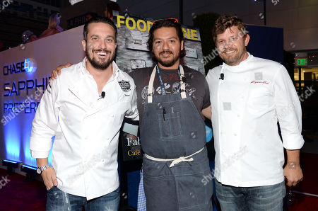 Chefs Fabio Viviani, left, Ray Garcia and Ben Ford participate in the Chase Sapphire Preferred Chef Challenge during the Ultimate Bites of L.A. at the Los Angeles Food & Wine Festival, presented by FOOD & WINE, on in Los Angeles