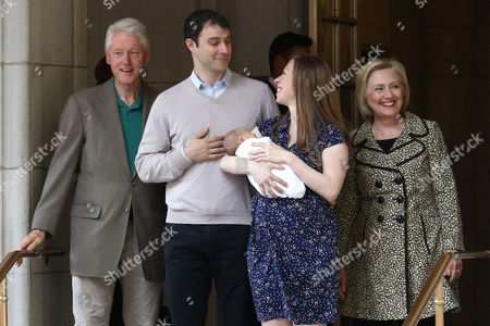 Bill Clinton, from left, Marc Mezvinsky, Chelsea Clinton with newborn son, Aidan Clinton Mezvinsky and Hillary Clinton leave Lenox Hill Hospital, in New York