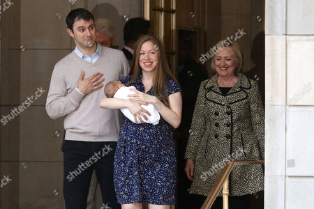 Marc Mezvinsky, from left, Chelsea Clinton with newborn son, Aidan Clinton Mezvinsky and Hillary Clinton leave Lenox Hill Hospital, in New York
