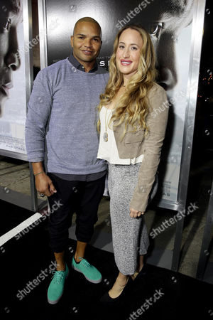 Stock Photo of Brendon Ayanbadejo and Natalee Uzcategui seen at Columbia Pictures Special screening of 'Concussion' at Regency Village Theatre, in Los Angeles, CA