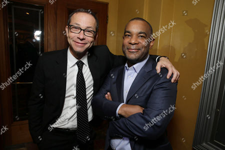 Stock Image of CAA's Richard Lovett and Overbrook Entertainment Co-Founder/Partner James Lassiter seen at Columbia Pictures Special screening of 'Concussion' at Regency Village Theatre, in Los Angeles, CA