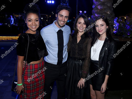 """From left, Aisha Dee, Richard Brancatisano, Italia Ricci, and Haley Ramm pose together at the """"Crush by ABC Family"""" collection launch party at The London hotel in West Hollywood, Calif. on"""