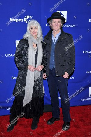 "Musicians Emmy Lou Harris, left, and Rodney Crowell pose for photographers at ""Play It Forward: A Celebration of Music's Evolution and Influencers"" at the Grammy Foundation's 15th Annual Music Preservation Project, in Los Angeles"