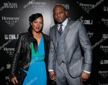 Stock Photo of Omar Epps (R) and Keisha Spivey attend a private dinner hosted by Hennessy V.S.O.P Privilege and LL COOL J at Hinoki and the Bird in celebration of Music's Biggest Night on Saturday, February 7, in Los Angeles