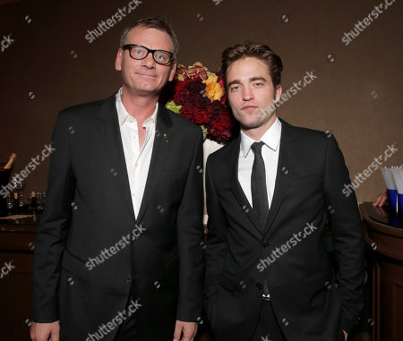 HFPA President Theo Kingma and actor Robert Pattinson attend the Hollywood Foreign Press Association's Grants Banquet at the Beverly Hilton hotel, in Beverly Hills, Calif