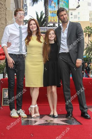 Actress Julianne Moore and family, husband Bart Freundlich and children Liv and Caleb attend as Moore is honored with a star on the Hollywood Walk of Fame on in Los Angeles