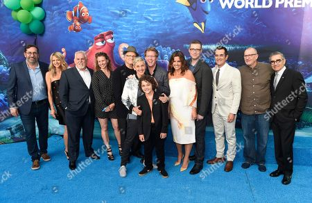 "Bob Peterson, from left, Kaitlin Olson, John Ratzenberger, Victoria Strouse, Albert Brooks, Ellen DeGeneres, Hayden Rolence, foreground, writer/director Andrew Stanton, producer Lindsey Collins, co-director Angus MacLane, Ty Burrell, Ed O'Neill and Eugene Levy arrive at the premiere of ""Finding Dory"" at the El Capitan Theatre, in Los Angeles"