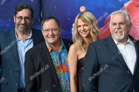 "Bob Peterson, from left, executive producer John Lasseter, Kaitlin Olson, John Ratzenberger arrive at the premiere of ""Finding Dory"" at the El Capitan Theatre, in Los Angeles"
