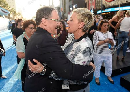 "Executive producer John Lasseter, left, and Ellen DeGeneres arrive at the premiere of ""Finding Dory"" at the El Capitan Theatre, in Los Angeles"