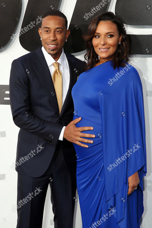 """Stock Picture of Ludacris, left, and Eudoxie Agnan arrive at the premiere of """"Furious 7"""" at the TCL Chinese Theatre IMAX, in Los Angeles"""