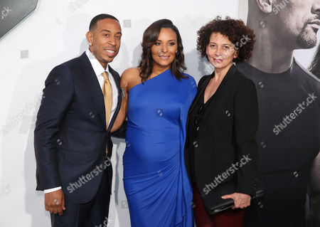 """Stock Photo of Ludacris, from left, Eudoxie Agnan and Donna Langley, chairman of Universal Pictures, arrive at the premiere of """"Furious 7"""" at the TCL Chinese Theatre IMAX, in Los Angeles"""
