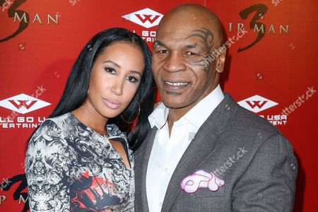 "Mike Tyson, right, and wife Lakiha Spicer arrive at the Premiere of ""Ip Man 3"" at Pacific Theatres at The Grove, in Los Angeles"