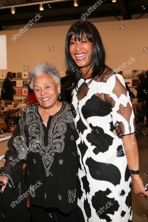 From left, artist Betye Saar and Joy Simmons pose during the 2014 Santa Monica Museum of Art PRECOGNITO Gala, in Santa Monica, Calif