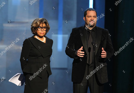 Diahann Carroll, left, and Benjamin Jealous, president and CEO of the NAACP, present the Presidents award to Kerry Washington at the 44th Annual NAACP Image Awards at the Shrine Auditorium in Los Angeles on
