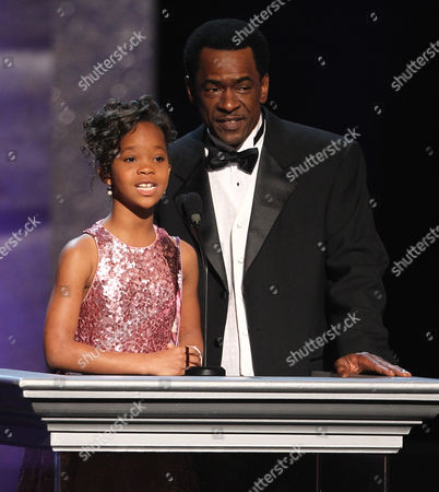 Quvenzhane Wallis, left, and Dwight Henry speak onstage at the 44th Annual NAACP Image Awards at the Shrine Auditorium in Los Angeles on