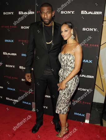 """Amar'e Stoudemire, left, and Alexis Welch, right, attend a screening of """"The Equalizer"""" on in New York"""