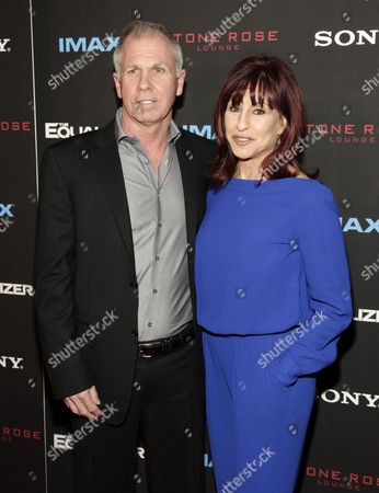 """Richard Wenk, left, and Allison Wenk, right, attend a screening of """"The Equalizer"""" on in New York"""