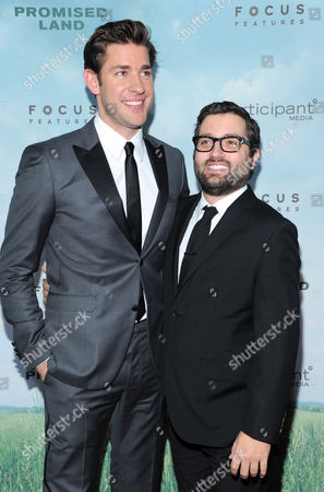"""Stock Photo of Actor John Krasinski, left, and producer Mike Sablone attend the premiere of """"Promised Land"""" at AMC Loews Lincoln Square on in New York"""