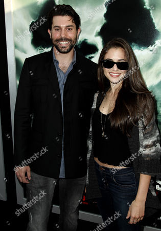"""Micah Sloat, left, arrives at the premiere of """"Chernobyl Diaries"""" on in Los Angeles"""