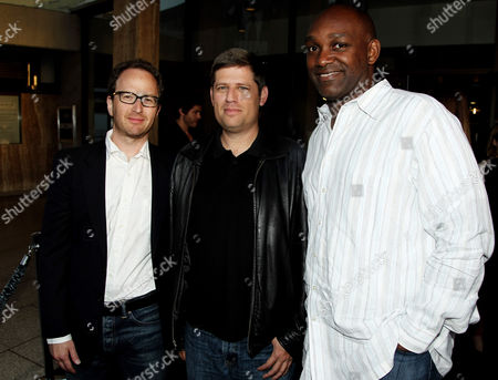 """Stock Picture of Producer Brian Witten, left, writer and producer Oren Peli, center, and producer Broderick Johnson pose together at the premiere of """"Chernobyl Diaries"""" on in Los Angeles"""