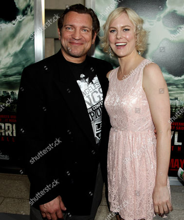 "Cast members Dimitri Diatchenko, left, and Ingrid Bolso Berdal pose together at the premiere of ""Chernobyl Diaries"" on in Los Angeles"