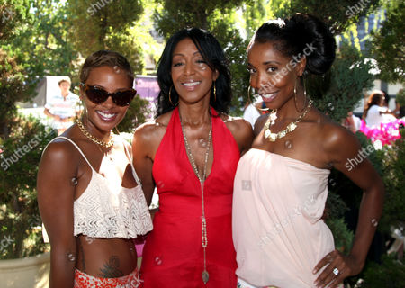 "Eva Pigford, Robi Reed, center, and Kita Williams, right, pose for a photo at Robi Reed's 10th Annual ""Sunshine Beyond Summer"" Celebration - The Day Party with a Purpose at the Getty House, in Los Angeles"