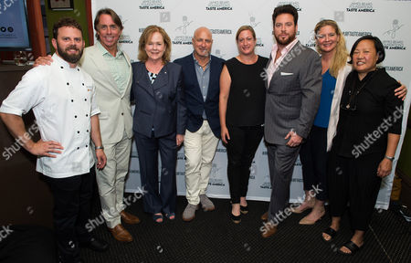 Bryan Hunt, from left, John Besh, Susan Ungaro, Tom Colicchio, Missy Robbins, Scott Conant, Amanda Freitag and Anita Lo attend the kick-off event for the James Beard Foundation's Taste America's 10-city national tour, held at the James Beard House in New York City