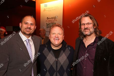 """From left, director Marc Warzecha, cast member Larry Joe Campbell and vocal music director David O pose during the party for the opening night performance of The Second City's """"A Christmas Carol: Twist Your Dickens!"""" at the Center Theatre Group's Kirk Douglas Theatre, in Culver City, Calif"""