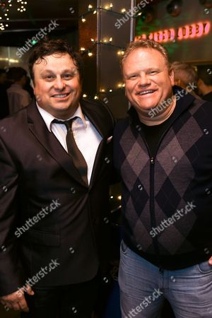"""From left, cast members Frank Caeti and Larry Joe Campbell pose during the party for the opening night performance of The Second City's """"A Christmas Carol: Twist Your Dickens!"""" at the Center Theatre Group's Kirk Douglas Theatre, in Culver City, Calif"""