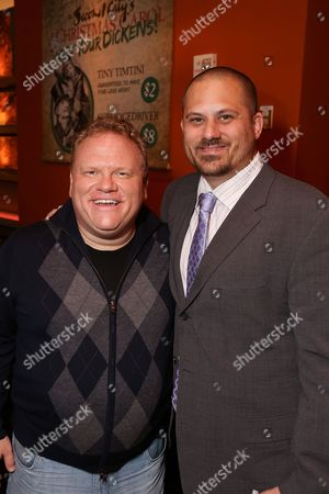 """From left, cast member Larry Joe Campbell and director Marc Warzecha pose during the party for the opening night performance of The Second City's """"A Christmas Carol: Twist Your Dickens!"""" at the Center Theatre Group's Kirk Douglas Theatre, in Culver City, Calif"""