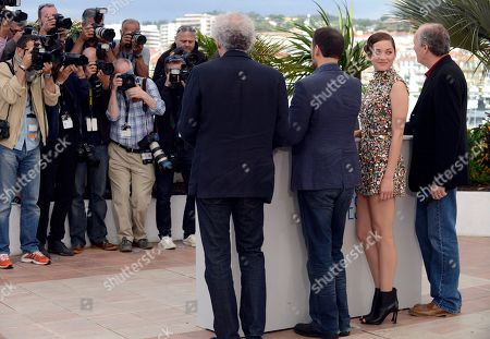 Jean-Pierre Dardenne, Fabrizio Rongione, Marion Cotillard and Luc Dardenne during a photo call for Two Days, One Night (Deux jours, une nuit) at the 67th international film festival, Cannes, southern France