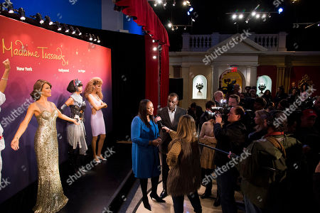 Pat Houston, center, and Gary Houston unveil Whitney Houston wax figures at Madame Tussauds in New York on