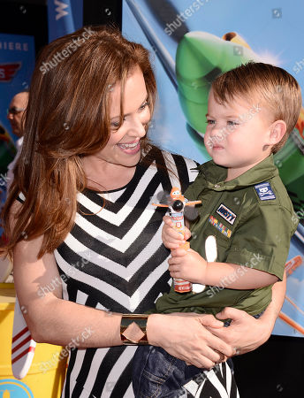 """From left to right, actress Alyssa Milano and son Milo Bugliari arrive on the red carpet of the world premiere of Disney's """"Planes"""" at the El Capitan Theatre on Monday, August, 5, 2013 in Los Angeles"""