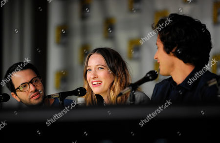 """Sophie Lowe, center, speaks as Edward Kitsis, left, and Peter Godiet, right, look on at the """"Once Upon Time in Wonderland"""" panel on Day 4 of the 2013 Comic-Con International Convention on in San Diego"""