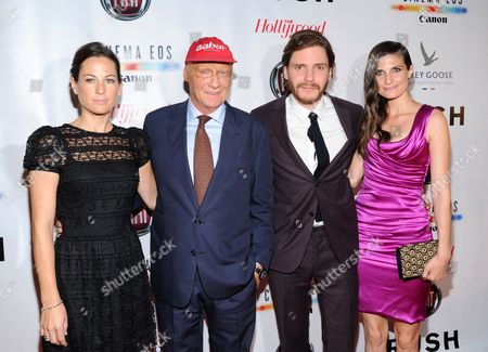 """From left, Birgit Wetzinger, Niki Lauda, Daniel Bruhl and Felicitas Rombold arrive at Universal Pictures """"RUSH"""" premiere after party sponsored by The Hollywood Reporter at The Thompson Hotel on day 4 of the Toronto International Film Festival, in Toronto"""