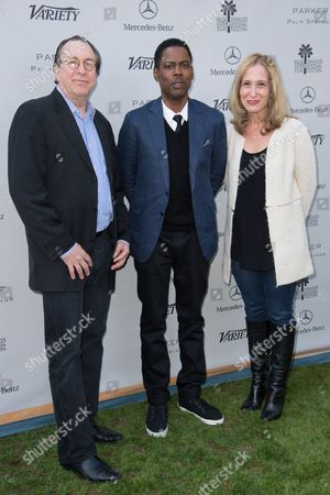 Stock Picture of Steve Gaydos, left, Chris Rock, center, and Michelle Sobrino-Stearns, right, arrive at Variety's 10 Directors to Watch and Creative Impact Awards Presented by Mercedes-Benz at the Parker Palm Springs on ], in Palm Springs, Calif