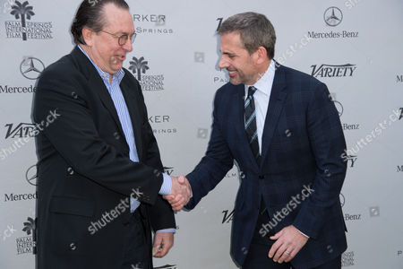 Stock Photo of Steve Gaydos, left, and Steve Carell, right, arrive at Variety's 10 Directors to Watch and Creative Impact Awards Presented by Mercedes-Benz at the Parker Palm Springs on ], in Palm Springs, Calif