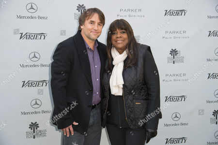 Richard Linklater, left and Chaz Ebert, right arrive at Variety's 10 Directors to Watch and Creative Impact Awards at the Parker Palm Springs, in Palm Springs, Calif