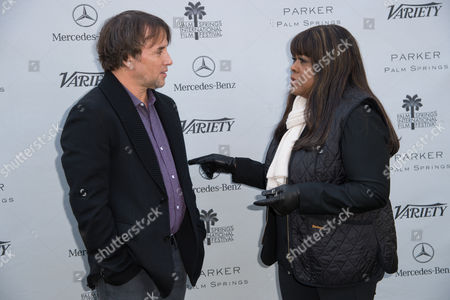 Richard Linklater, left and Chaz Ebert, right arrive at Variety's 10 Directors to Watch and Creative Impact Awards Presented by Mercedes-Benz at the Parker Palm Springs on ], in Palm Springs, Calif