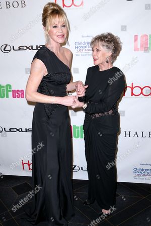 Melanie Griffith, left, and mother Tippi Hedren arrive at the 2nd Annual Hollywood Beauty Awards at the Avalon Hollywood, in Los Angeles