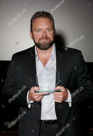 Joe Carnahan receives the Visionary Award at the 8th Annual HollyShorts Film Festival opening night celebration at Grauman's Chinese Theatre, in Los Angeles, CA