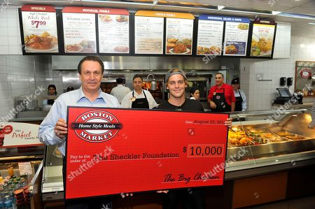 Boston Market CEO George Michel (A.K.A. The Big Chicken) presents a $10,000 check to pro skateboarder Ryan Sheckler at Boston Market during an event to benefit The Sheckler Foundation on in North Arlington, N.J