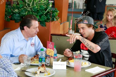 Boston Market CEO George Michel (A.K.A. The Big Chicken) and pro skateboarder Ryan Sheckler enjoy lunch at Boston Market during an event benefiting The Sheckler Foundation on in North Arlington, N.J