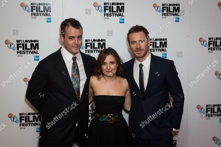 Alastair Siddons, Lyndsey Marshal and Michael Fassbender pose for photographers on arrival at the premiere of the film 'Trespass Against Us', showing as part of the London Film Festival in London