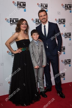 Lyndsey Marshal, Georgie Smith and Michael Fassbender pose for photographers on arrival at the premiere of the film 'Trespass Against Us', showing as part of the London Film Festival in London
