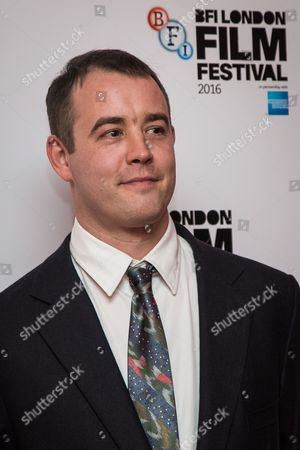 Writer Alastair Siddons poses for photographers on arrival at the premiere of the film 'Trespass Against Us', showing as part of the London Film Festival in London