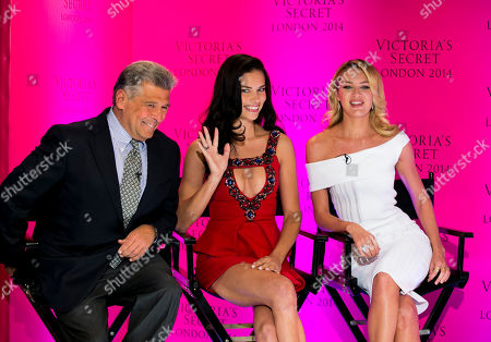 Chief Marketing Officer Ed Razek and Victoria's Secret models Candice Swanepoel and Adriana Lima during a press conference at the Victoria's Secret New Bond Street store in central London, The Victoria's Secret models have announced that the Victoria's Secret Fashion show will be coming to London this year