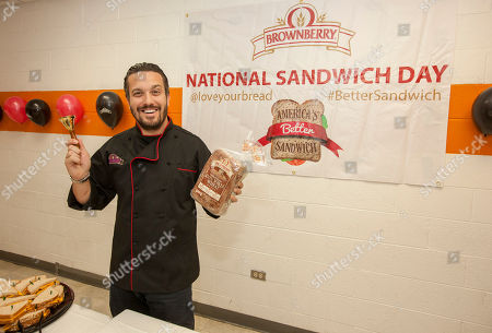 Chef Fabio Viviani seen here during the Brownberry Bread National Sandwich Day Event at The Boys & Girls Jordan Club on in Chicago