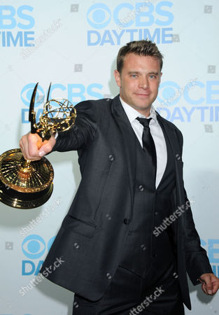 Billy Miller arrives at the Daytime Emmy Awards Afterparty at The Beverly Hilton, in Beverly Hills, Calif